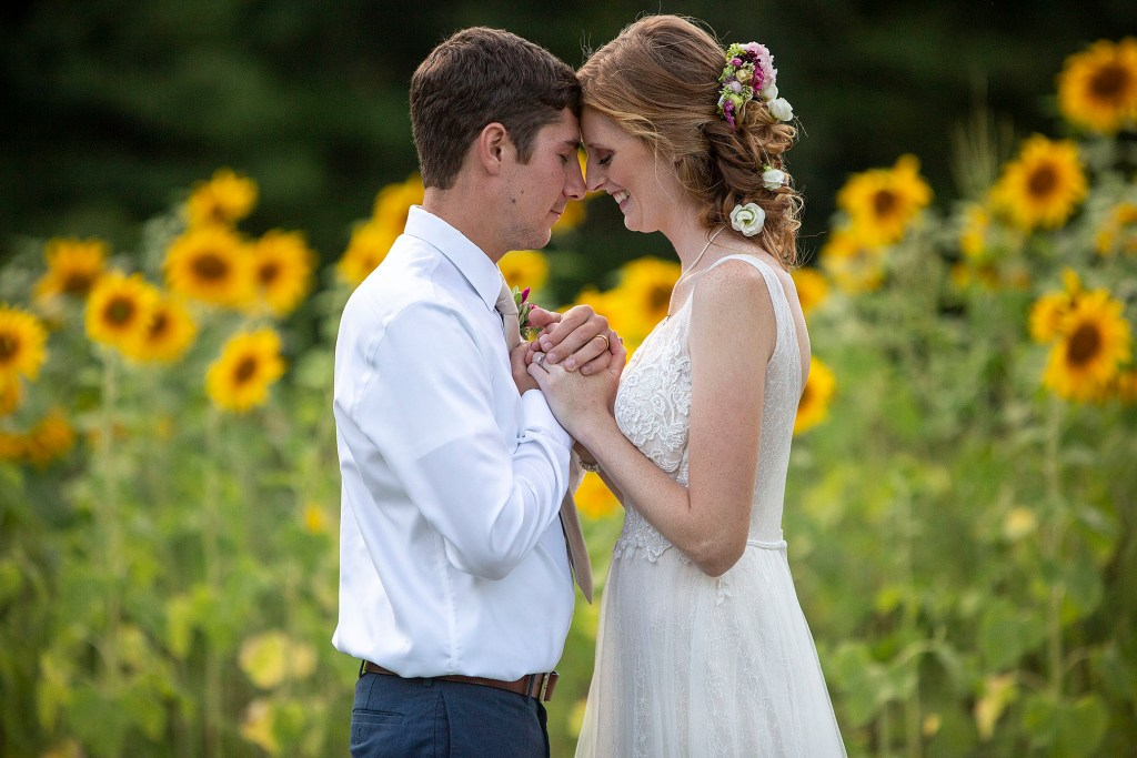 Couple touches foreheads together at their Belleville wedding