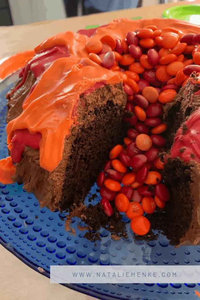 Volcano Birthday Party chocolate volcano bundt cake with M&M lava flow at www.nataliemenke.com