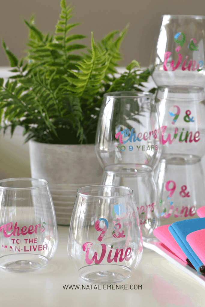 """custom wine glasses with the words """"9 and Wine"""" in floral vinyl"""