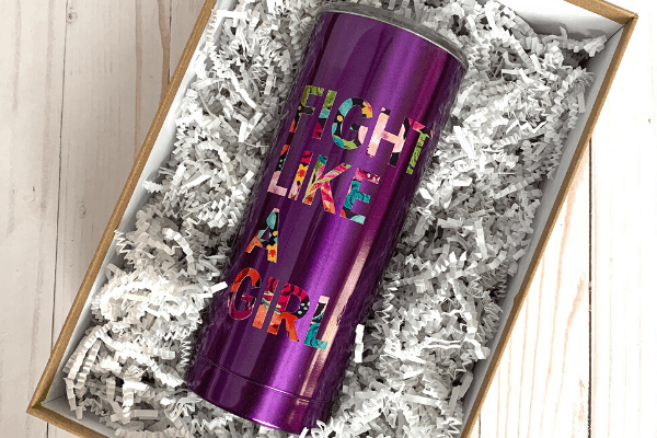 """purple tumbler with the words """"fight like a girl"""" in floral vinyl and tied with a pink ribbon"""