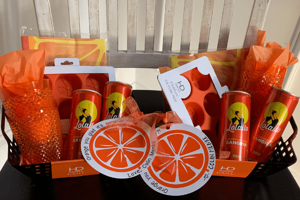 'Orange You Glad It's Summer' gift tag and orange-themed gift basket