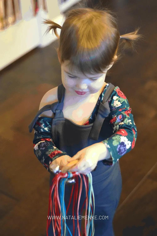 girl holding ribbons
