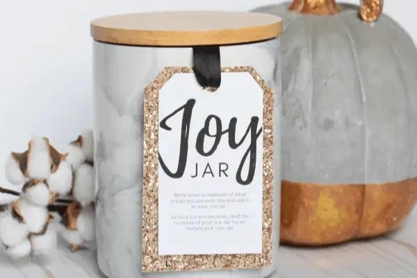 ceramic jar with a 'joy jar' gift tag