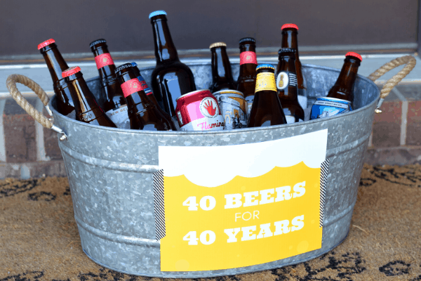 "bucket of beers with a sign that reads ""40 beers for 40 years"""