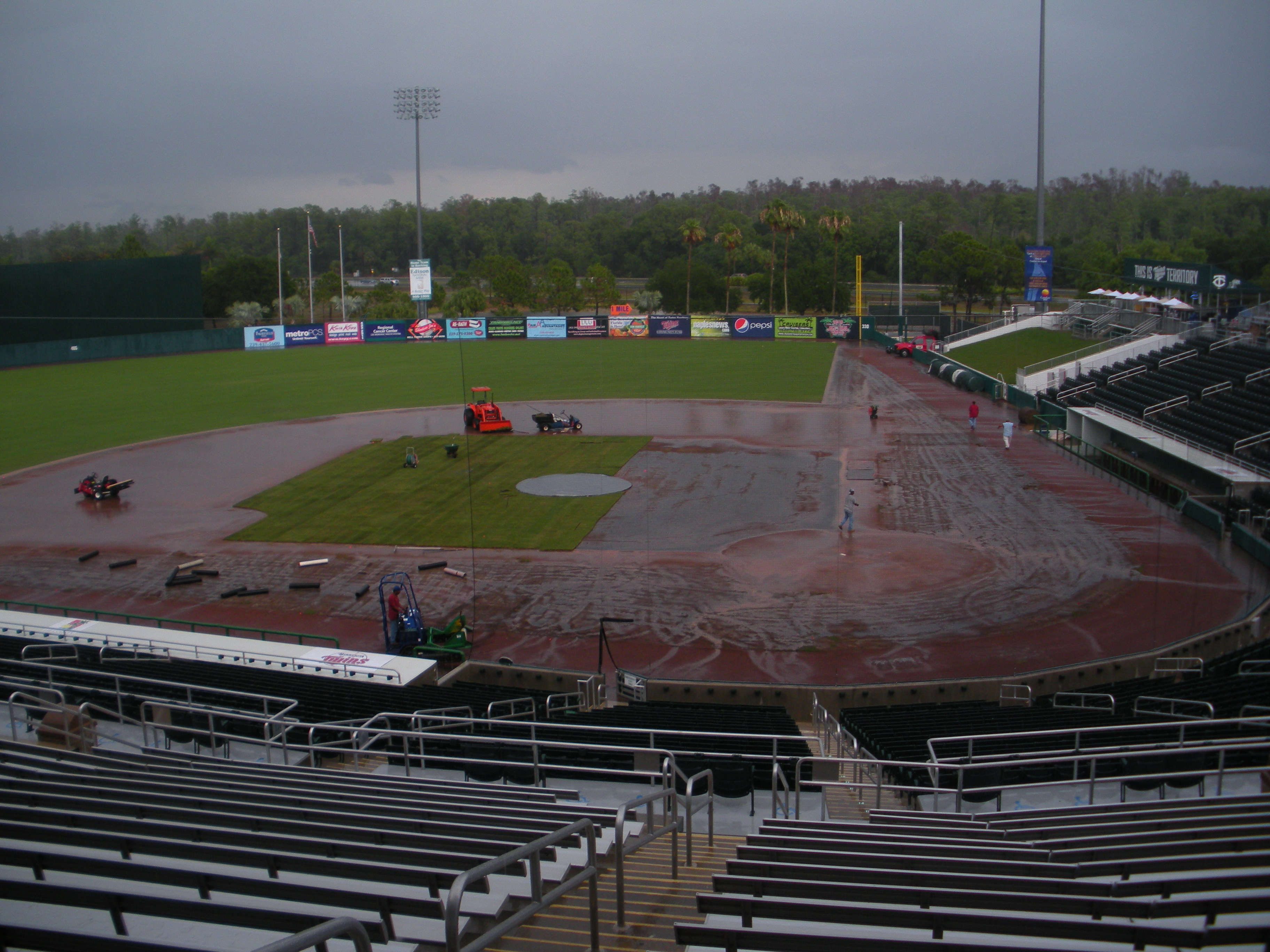 Weather: Torrential hurricane-like downpour aftermath. Field: Pitching mound sliding towards Visitor's dugout...
