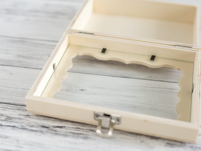 bend tabs to remove glass