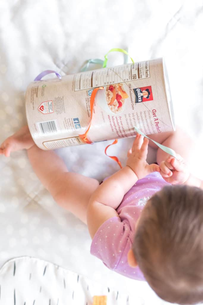 upcycled DIY fine motor toy with an oatmeal container