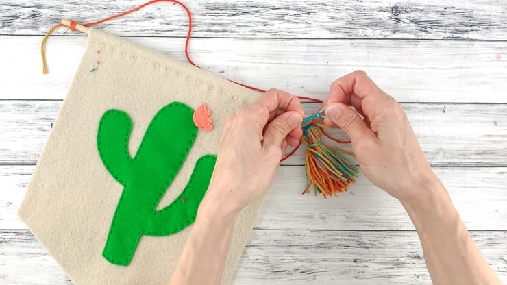 adding a tassel to cactus wall hanging
