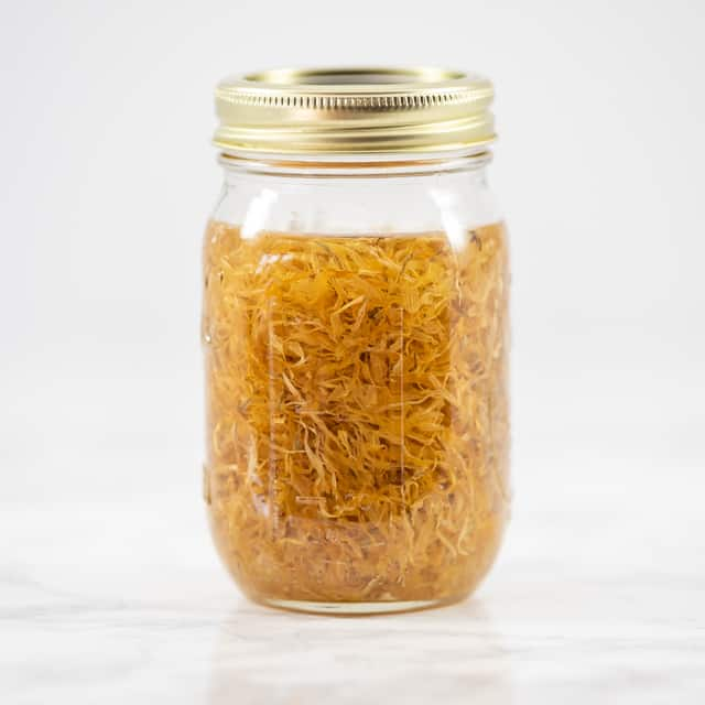 jar of oil with calendula petals
