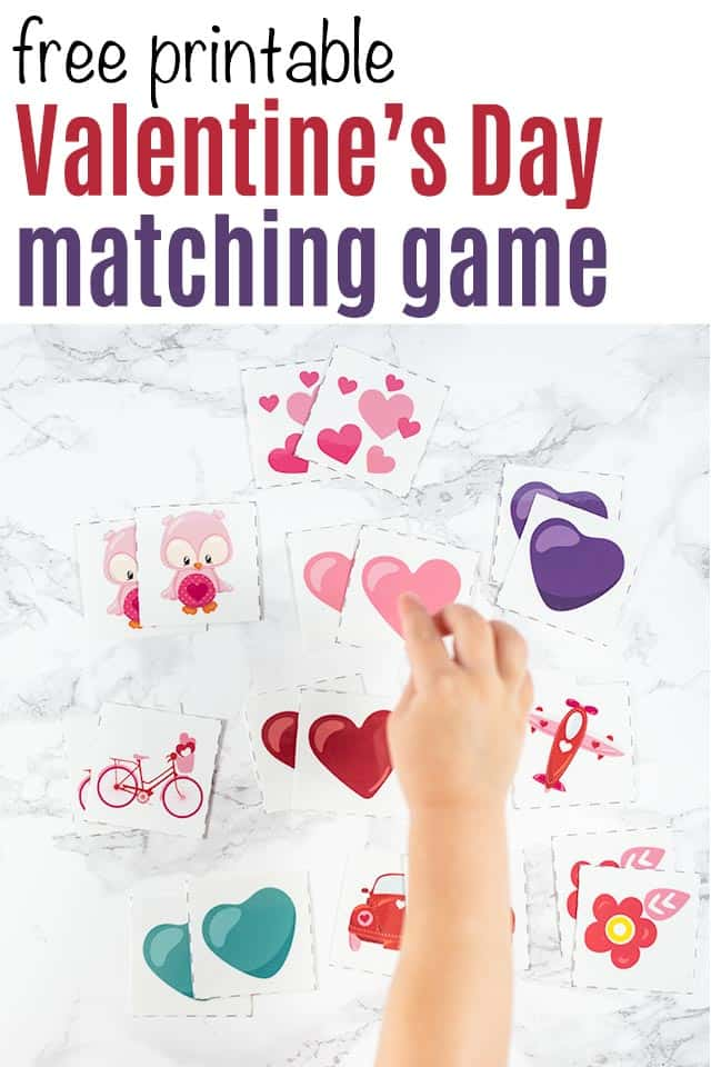 "text ""free printable Valentine's Day matching game"" with a picture of a toddler reaching for a pink heart in a set of printable matching game pieces"