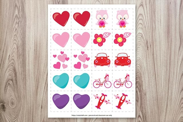 A preview of a free printable set of matching game cards for Valentine's Day on a wood background
