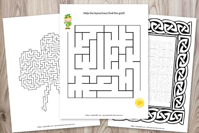 Three printable mazes for St. Patrick's Day on a wood background. One maze is easy, one is shaped like a shamrock, and the third maze is difficult