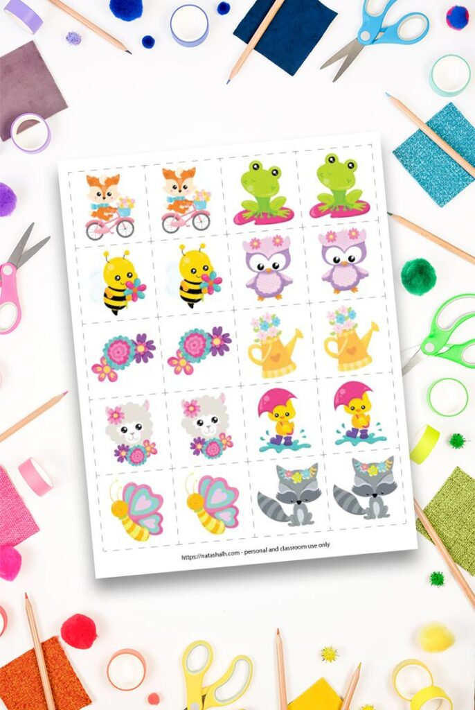 spring printable memory game with 10 different spring cartoon animals and flowers on top of a workspace with colorful children's scissors, washi tape, and pencils
