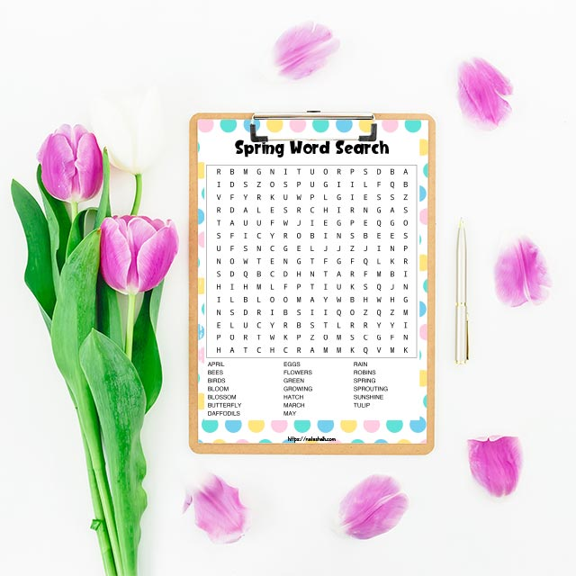 free printable spring word search on a clipboard. The cupboard is on a white background with tulips