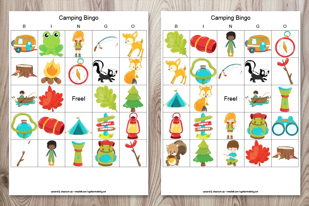 two free printable camping bingo boards on a wood background