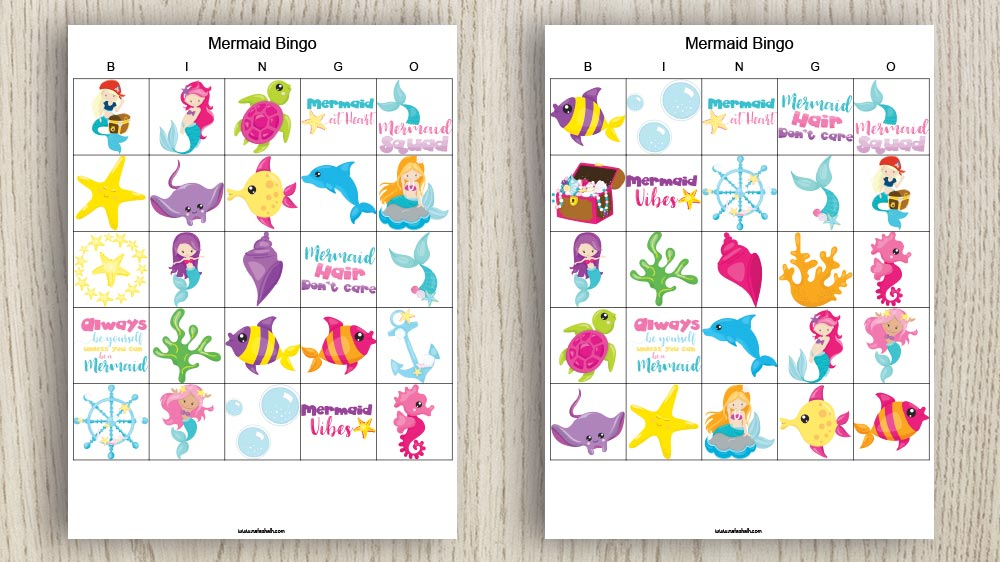 two free printable mermaid bingo cards on a wood background. The cards feature brightly colored mermaid and undersea themed images
