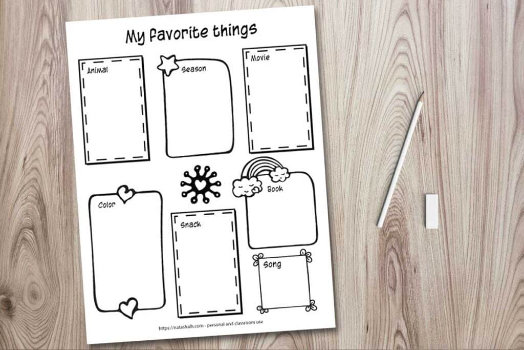 """A printable worksheet mockup on a wood background with a cup of colorful pens, a pencil, and an eraser. The worksheet says """"my favorite things"""" across the top ands seven hand drawn doodle frames for a child to write or draw their favorite animal, season, movie, color, snack, book, and song."""