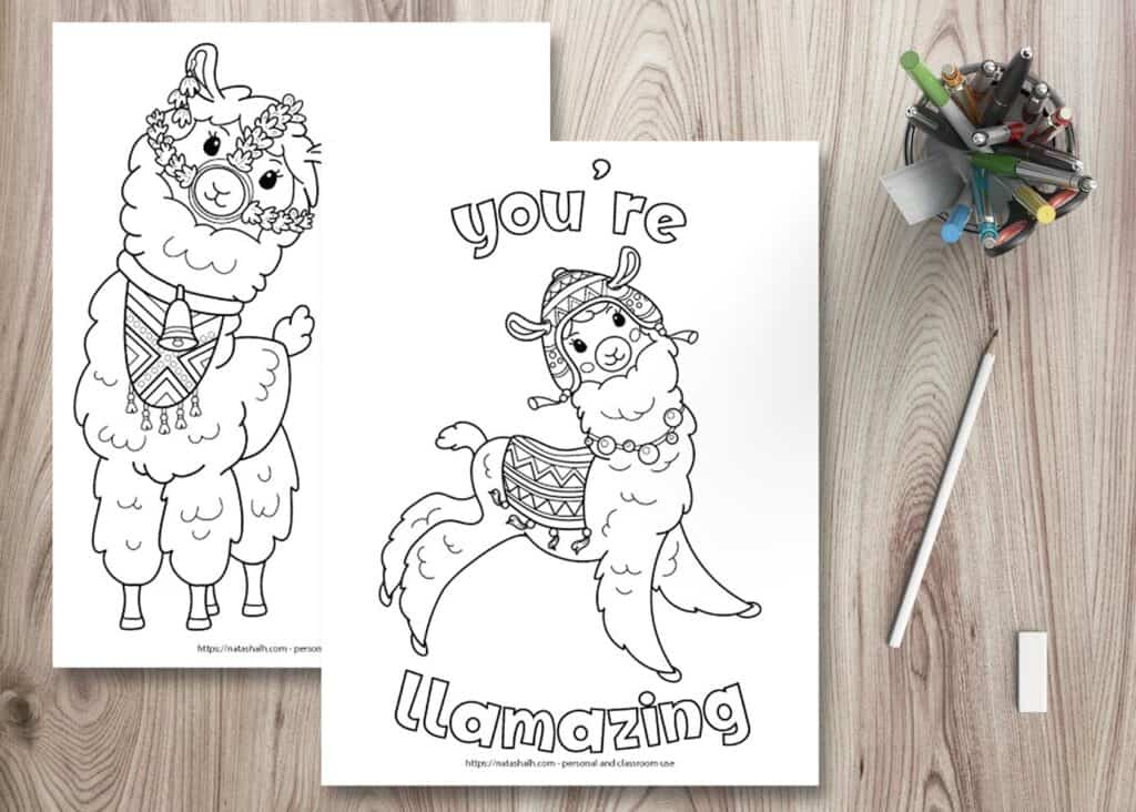 "Two free printable llama coloring pages on a wood background. There is a cup full of pens in the top right. Below the pen cup is a pencil and an eraser. The coloring pages are layered on top of one another. The front page says ""you're llamazing"" in bubble letters with a jumping llama waring a blanket and chulo hat. The page behind is partially obscured and has a front-facing llama wearing a bell and halter made of flowers."