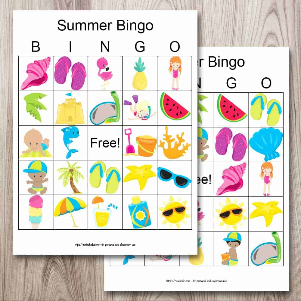 Two printable summer bingo cards on a wood background. The cards are placed so that one is on top of the other, obscuring half of the card behind. Each bingo card printable features 24 cartoon summer images like a beach ball, flip flops, an umbrella, and ice cream.