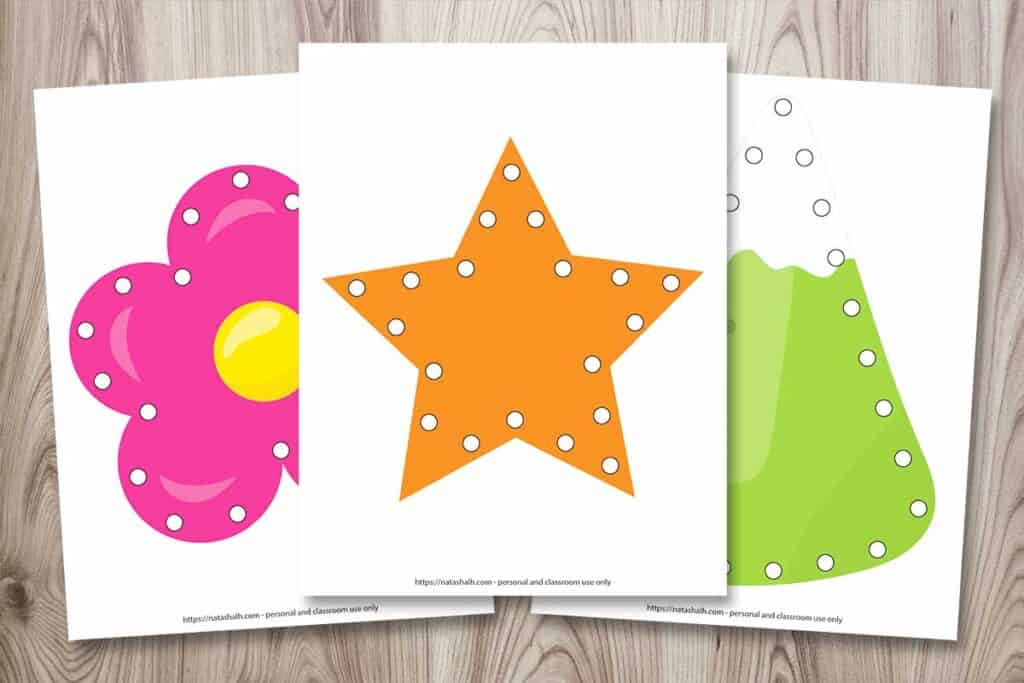 Three printable lacing cards for young children. One card is a pink flower. Another card is an orange star. The third image is a green mountain.