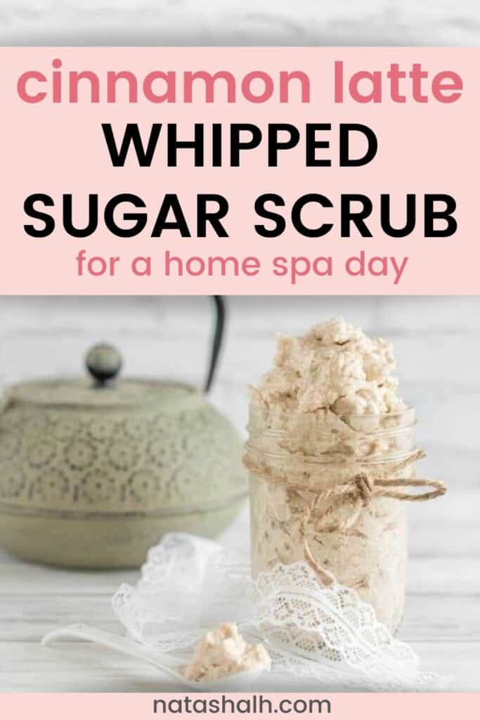 "Text ""cinnamon latte sugar scrub for a home spa day' with a picture of a jar of whipped sugar scrub made with shea butter and cinnamon."