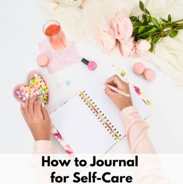 "text overlay ""how to journal for self-care"" at the bottom of an image of a woman in a pink shirt journaling next to macrons, a bowl of candy hearts, a glass of pink champaign, a bottle of nail polish, and a bouquet of pink flowers."