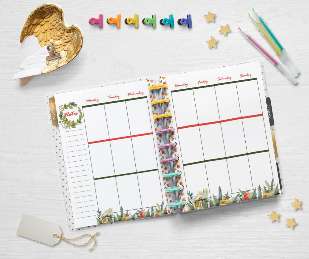 A flatly of an open Happy Planner Classic with printable interests for December. There are planning supplies like gel pens and binder clips as well as a Christmas gift tag and small stars on the table around the planner
