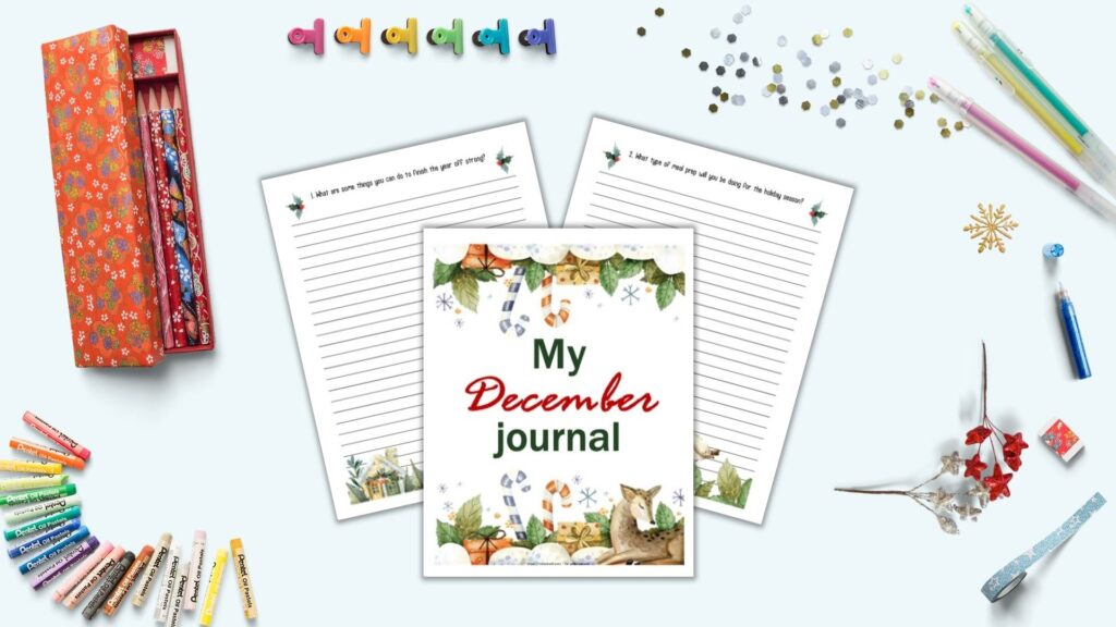"A flatly mockup with journaling supplies and three journal pages in the center on a light blue background. The pages include ""My December Journal"" with watercolor illustrations in the front and center. Behind are two lines pages with journal prompts at the top and a watercolor border at the bottom. Props on the surface include gel pens, glitter, blue washiest tape, and a Japanese pencil case with red flowers and pencils."