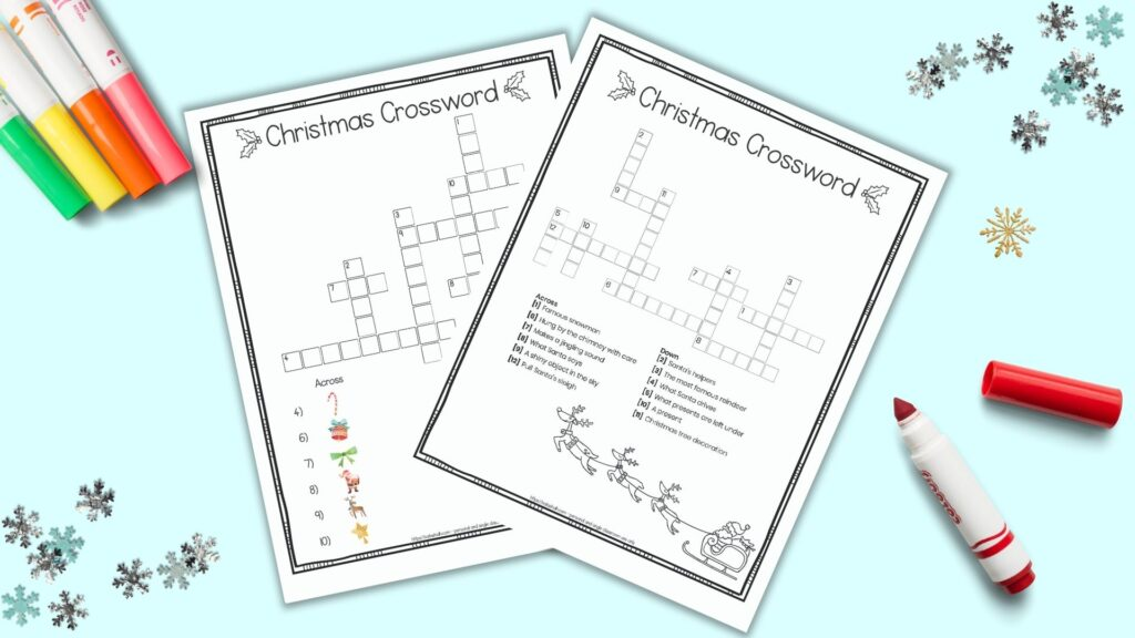 Two free printable Christmas crossword puzzles for children with a doodle frame border and black and white image of Santa with his sleigh. One puzzle has picture clues for young children and the other has text clues for elementary students. The puzzles are on a blue background surrounded by children's markers and snowflake shaped confetti.