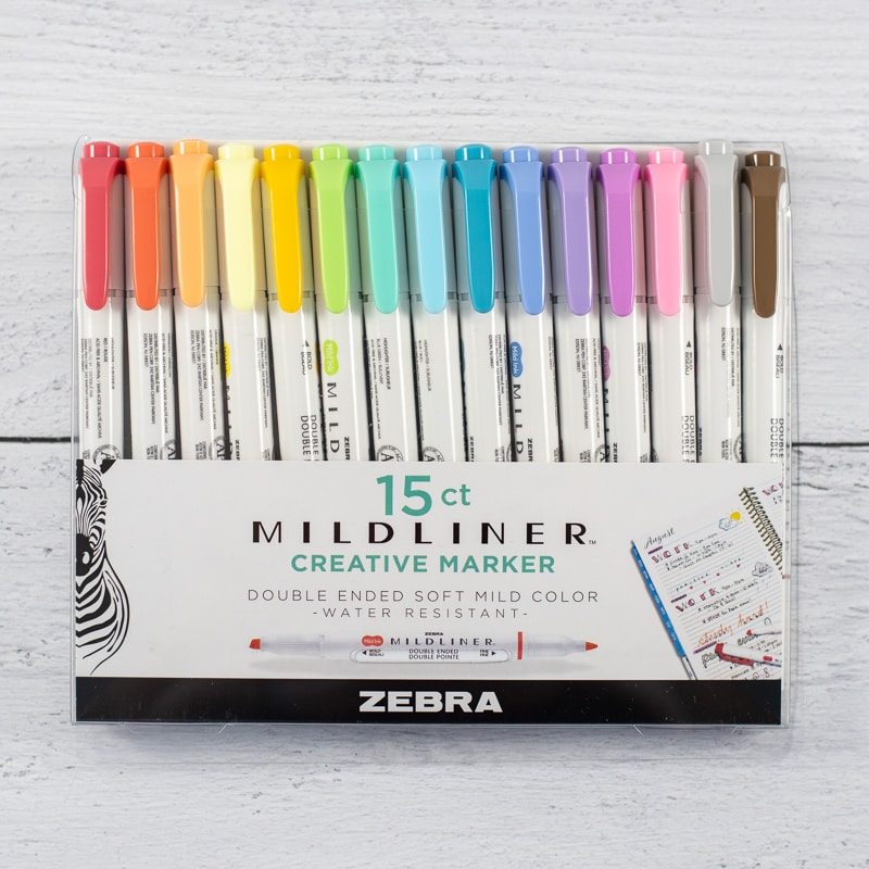 A box of 15 Zebra brand milliner markers/highlighters on a white wood background