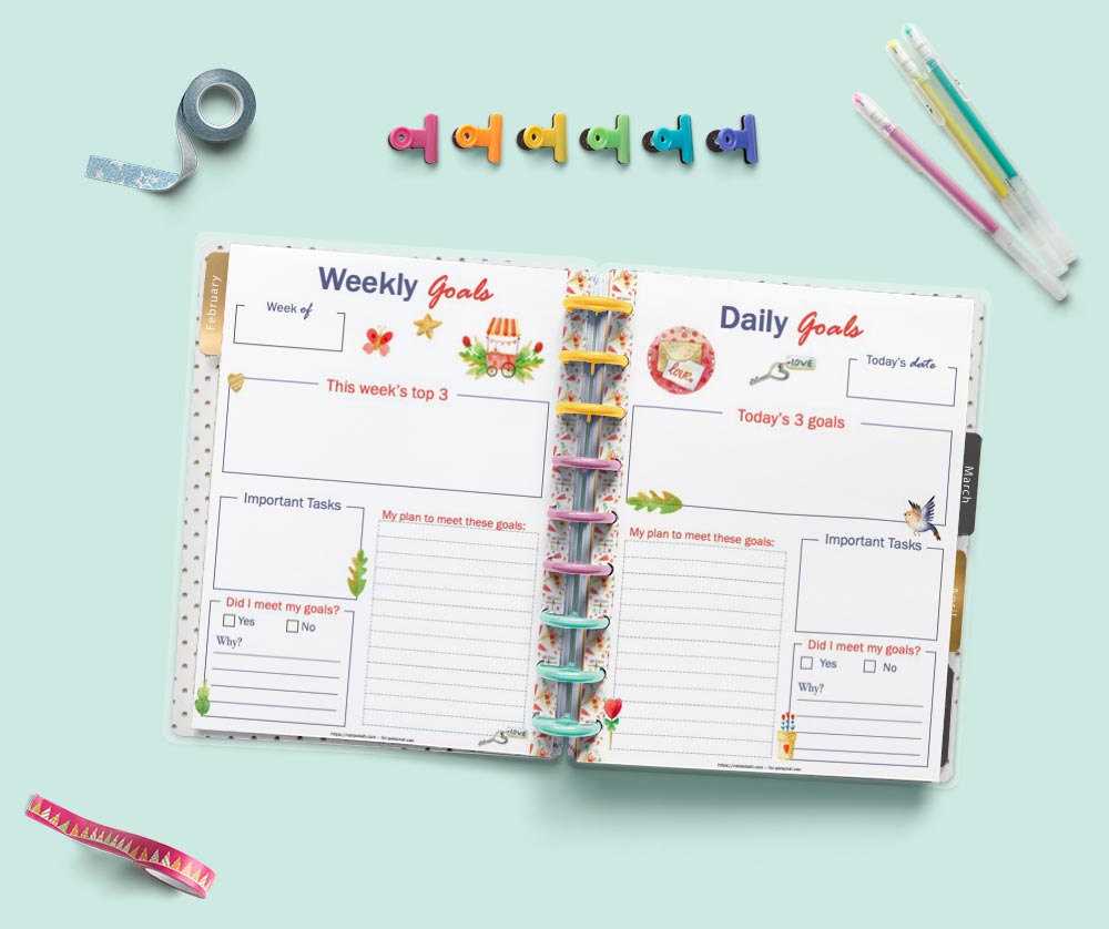 An open Happy Planner Classic showing weekly goals and daily goals planner pages with a Valentine's Day theme