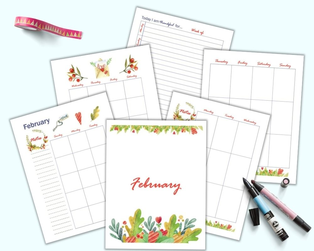 A flatlay mockup of 6 pages of free printable February planner pages including a cover page, monthly two page spread, vertical weekly two page spread, and gratitude journal page