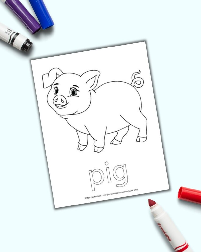 "A free printable pig coloring page with ""pig"" in bubble letters to color. The page is next to an open red child's marker on a blue surface."