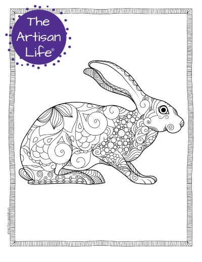 """A preview of a hare coloring page for adults. The hare is shown from the side and has hand drawn doodles to color and the page is bordered by a doodle frame. A purple round logo reading """"the artisan life®"""" is in the corner."""
