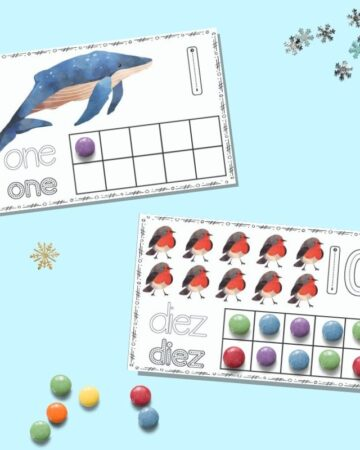 "Two printable winter ten frame cards on a blue background. The upper card has ""one"" and a single whale with a purple candy in the first spot on the ten frame. The lower card has ""diez"" with ten red robins and all squares on the ten frame filled in."