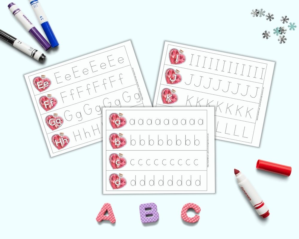 An image with three tracing strip page printables. Each page has four letters on a bottle filled with hearts. One letter is on each bottle. Next to the bottle is a row of the same letter to trace in a dotted font. Around the pages are foam letters a, b, and c as well as brightly colored children's markers.