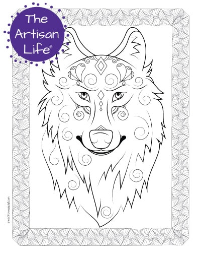 """A preview of a wolf's face coloring page for adults. The wolf has hand drawn doodles and swirls to color and the page is bordered by a doodle frame. A purple round logo reading """"the artisan life®"""" is in the corner."""