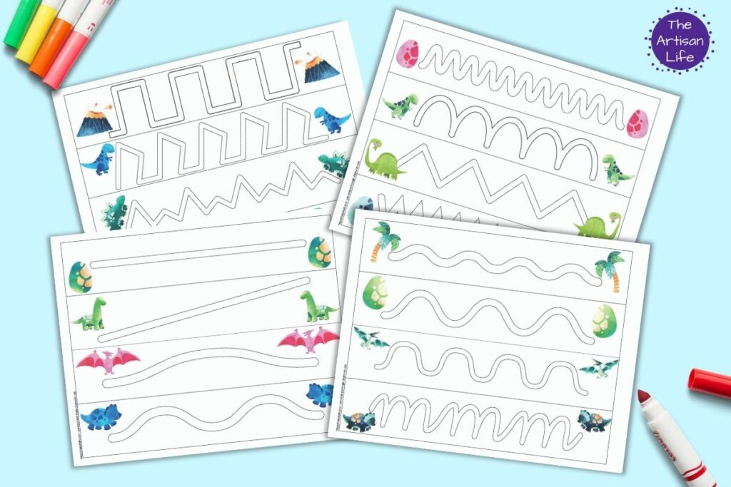 A flatlay preview of four printable dinosaur trace in the path prewriting pages. Each page has four paths to trace to built prewriting skills. There is a dinosaur related clipart image at the beginning and end of each path. The pages are on a blue surface with colorful children's markers.