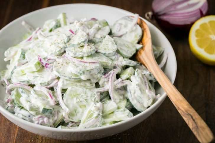 Close up of Creamy Cucumber Salad with fresh lemon juice and red onions