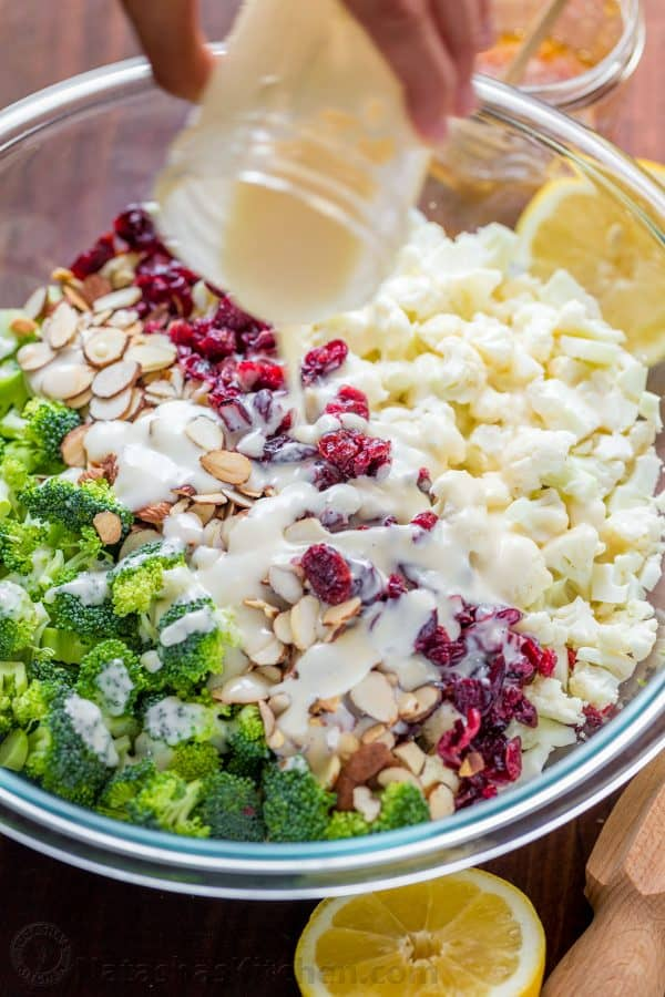 Drizzle the broccoli and cauliflower salad with creamy dressing