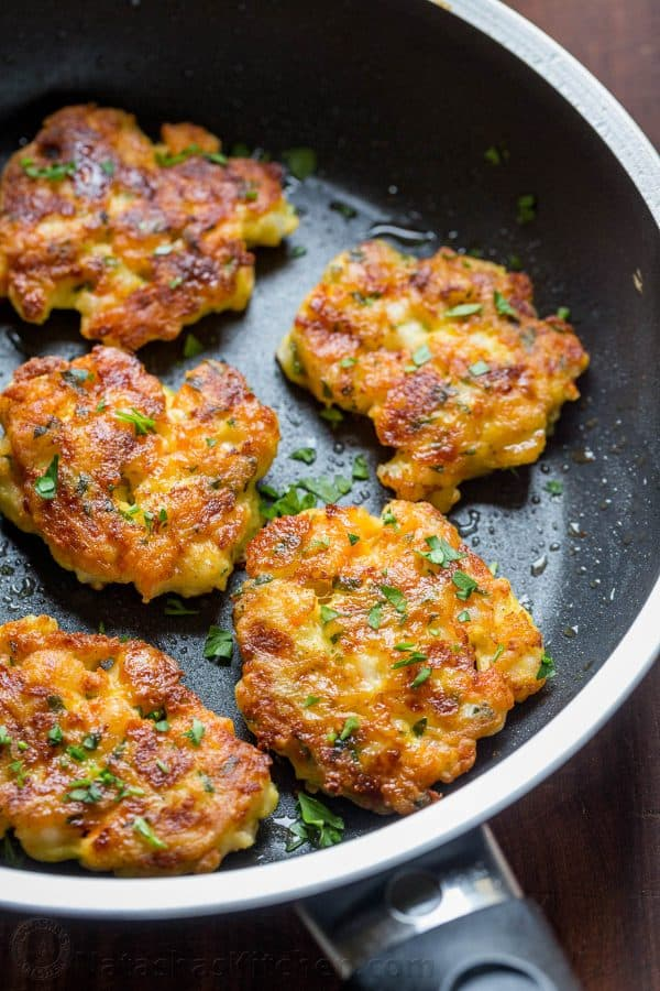 Sauteed Shrimp cakes in pan garnished with parsley