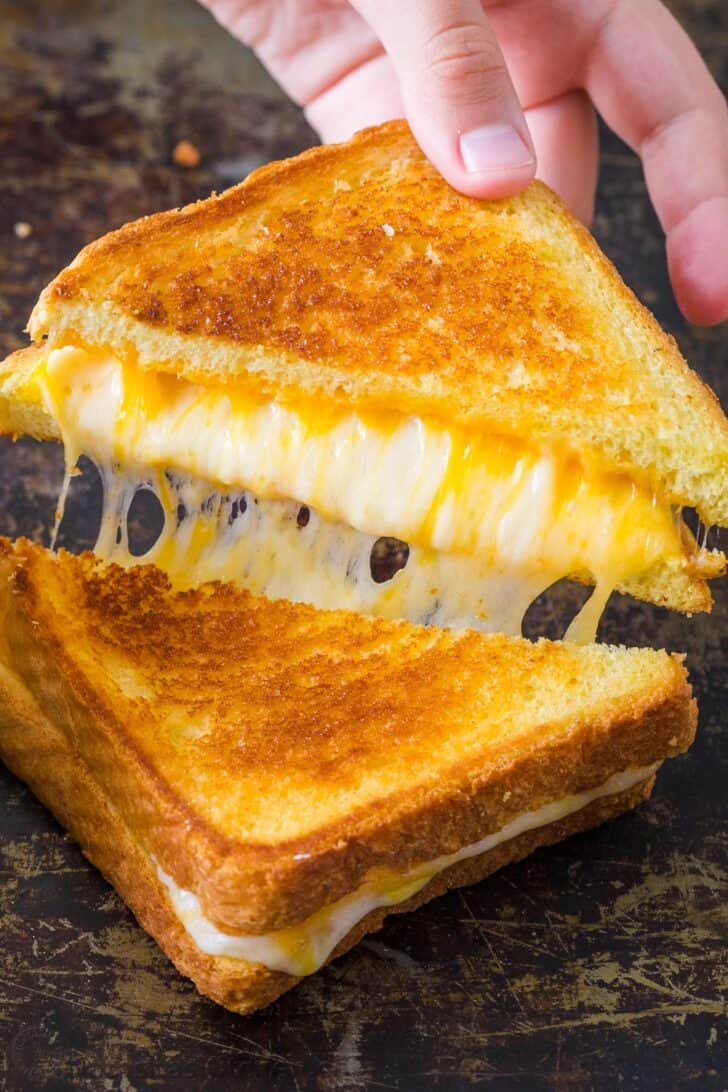 Grilled Cheese cut in half showing cheesy center