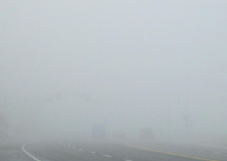 Dense tule fog often shrouds the highways in Bakersfield, California. Visibility in this photograph is less than 500 feet. (Courtesy Wikipedia)