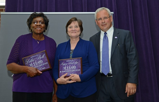 Lillie Frazier Bell and Peggy Lodridge were recognized for 30 years of service at Northwestern State University during the school's annual faculty/staff lunch.  Bell is the University Registrar and Lodridge is retiring as campus manager of NSU's CENLA campus.  They were congratulated by NSU President Dr. Jim Henderson.    Not shown are Kenny Turnley, operating engineer master for Facilities Services, and Annette Greathouse, custodian at the Nursing Education Center.