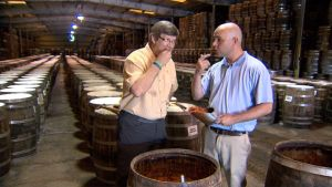 Charlie tasting Tabasco pepper mash out of an old oak barrel during my tour of the Tabasco Pepper Sauce plant at Avery Island.  This pepper mash is ten times hotter than Tabasco sauce.  It's just one of the adventures you will see tonight.