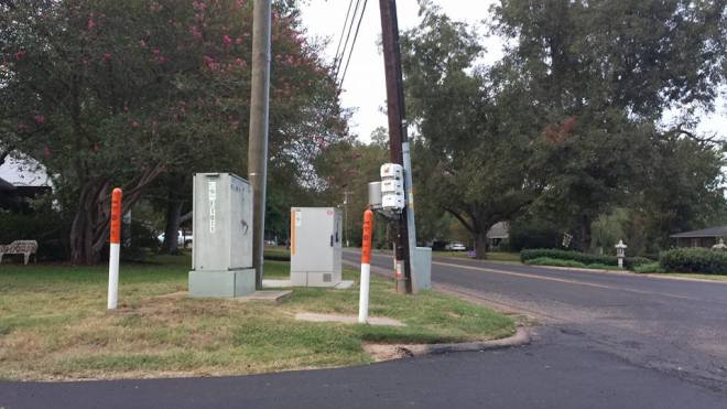 The utility boxes and make entering Williams Ave dangerous.