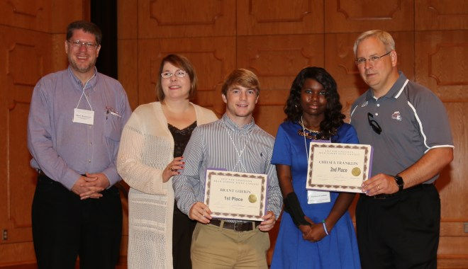 Brant Guerin of Greenwell Springs won first and Chelsea Franklin of Crowley won first and second place in the Louisiana High School Essay Contest held in conjunction with the Northwestern State University-sponsored Louisiana Studies Conference.  From left are Dr. Shane Rasmussen, conference chair;  Dr. Lisa Abney, provost and vice president for Academic Affairs;  Guerin, Franklin and NSU President Dr. Jim Henderson.  Not shown is third place winner Andrea Bradley of Ville Platte
