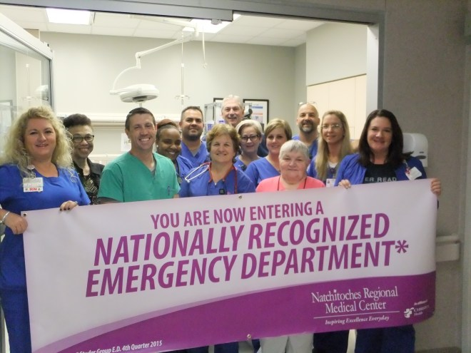 The Natchitoches Regional Medical Center Emergency Department was recently recognized by The Studer Group as Emergency Department of the Quarter for the 4th quarter of 2015. Proudly displaying their banner are members of the NRMC Emergency Department team: Michelle Garlington, Nursing Unit Manager; Pat Bailey, Charge Nurse; Dr. Marc Stokes, Medical Director for the Department of Emergency Medicine and Natchitoches Emergency Services; Latrice Preylo, LPN; Tony Peluso, RN; Beverly Sauce, RN; Lisa Lesly, RN; Dr. Tim Collins, ED physician and Medical Director for Outpatient Clinics; Robynn Jett, RN; Miki Snyder, Volunteer; Robbie Jones, House Supervisor; Melissa Britten, RN and Tracy Bishop, Charge Nurse.