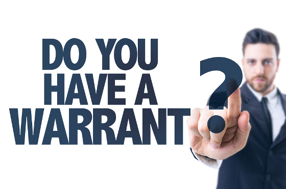 Business man pointing the text: Do You Have a Warrant?