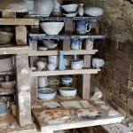 Pots stacked in the kiln on shelves